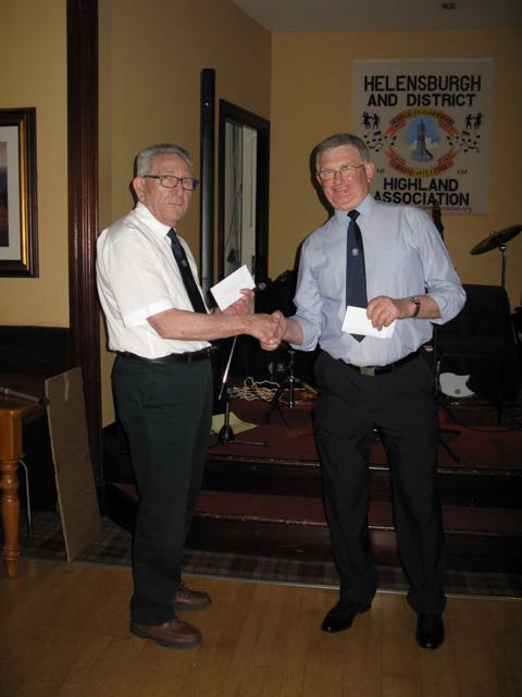Andy Rankin accepts donation for Multiple Sclerosis Society
