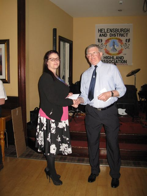 Nina Chapman accepts the Donation for Vale of Leven Autism and Aspergers Forum
