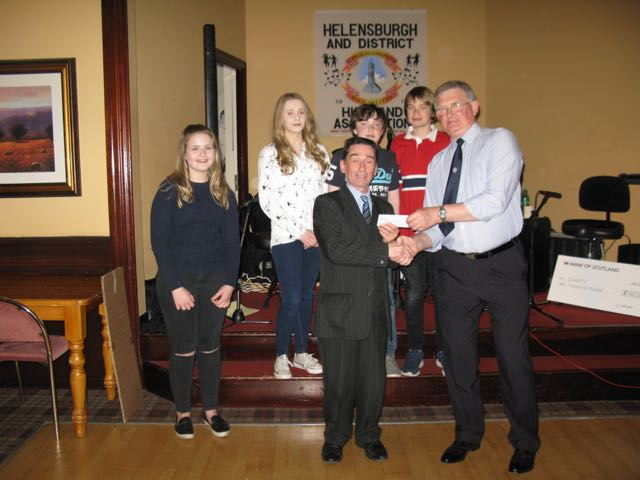 Representatives from the newly formed Youth Group in Cardross accept their Donation